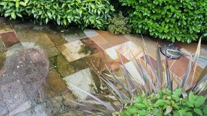 image of indian stone patio getting cleaned